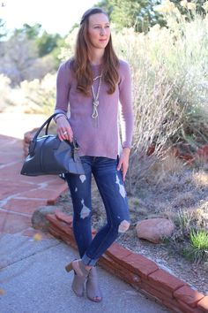 12 Fall Outfit Ideas for Moms | casual street style look with a knit sweater, distressed jeans, cut out booties, and pearl statement necklace | Click here to see all the outfits http://www.amodernmomblog.com/2016/09/fall-outfit-ideas/