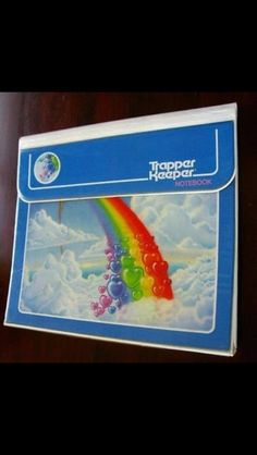 Trapper keeper...I had this exact one...when rainbows stood for rainbows...nothing more...nothing  less!!!