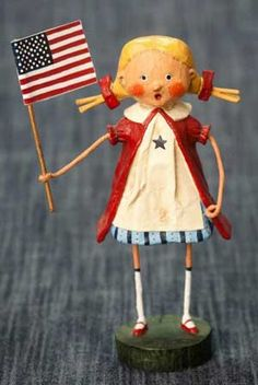 Gloria, a Lori Mitchell design for ESC and Company. Cast from Lori's original sculpted artwork, these figurines feature detailed carving, shaping, and painting. Stand 6.5 inches tall. Resin. A 2012 release. #lorimitchell #patriotic