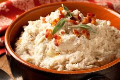 Onions, sour cream and Gruyere cheese put the Alsatian awesomeness into these bacon-studded mashed potatoes. Seriously—it's a must try.