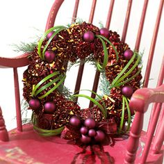 Roses are Red Wreath -  'Hocus Pocus' roses, in luscious red tinged in yellow, mingle with fresh juniper in this sweetly fragrant floral wreath. Matte and glossy ornaments feature two shades of red and provide a charming counterpoint to the bright green lilygrass wound throughout.