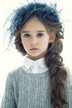 Her clothes and that thing on her head are horrid, but I LOVE her hair and eyes!!!!