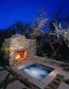 Hot tub and fireplace outside.