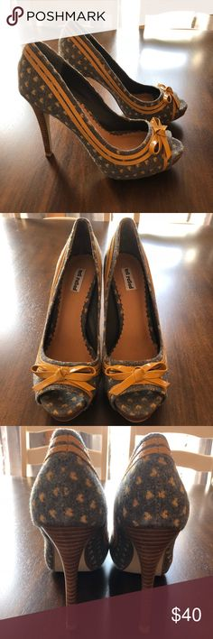 Not Rated gray and yellow retro heels size 8.5 Wonderful condition. Worn once. No scuffs or stains. Comes from a smoke free home. Heel height just under 5 inches. Not Rated Shoes Heels