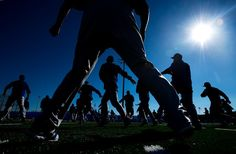 The Toronto Blue Jays stretch during spring training in Dunedin, Fla.    Credit: Nathan Denette/The Canadian Press, via Associated Press