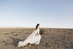this bride's dress is one-of-a-kind! made with a custom cape!