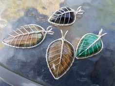 Just a bunch of gemstone leaf pendants that I wrapped (labradorites, malachite and tiger's eye).