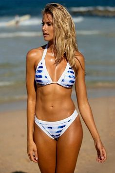 """Get ready for a day of sunshine in the Seas The Day Striped Bikini Set. Featuring a tie back padded top with removable pads and a Brazilian bikini bottom. Sizing: S-L Bust: S-31"""" (A/B cup size), M-34"""""""