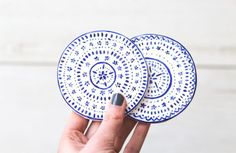 """By now you guys are probably aware that the simplest DIY's are usually my favourite to make and share. These hand-painted coasters by The Lovely Drawer are so cute and remind me of the """"good"""" china my..."""