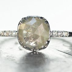 Our 1.5 carat light grey natural diamond ring in white gold. An elite ChincharMaloney one of a kind.  #jewelry #chincharmaloney