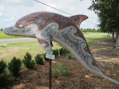 Driving around Virginia Beach you'll see these decorated dolphins (not two alike). Eleven of these dolphins are part of a Dolphin's Promise. This is a project that has been going on for about three years. The goal is to raise a million dollars for cancer research and also to help save and protect marine life.