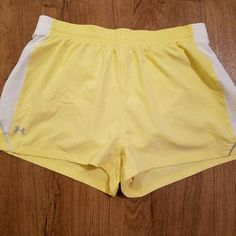 Under Armour Running Shorts Size Small Yellow Aloha! This item is a LIKE NEW pair of Under Armour women's running shorts, size small in a beautiful yellow color. These have been worn a couple times but are well cared-for, stain free, and look like a brand new item. Mahalo for browsing! Under Armour Shorts