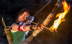 Portrait of Lara Croft character covered with blood and mud, she holds the bow with an arrow set on fire. Lara Croft, Lifestyle Photography, Cosplay, Portrait, Hair Styles, Mud, Arrow, Modeling, Blood