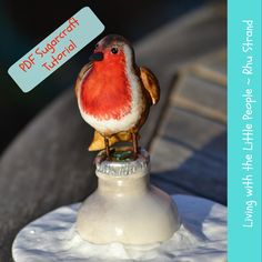 Robert is an adorable vintage robin sitting on top of the Christmas milk delivery, do you remember when milk was delivered and do you remember the silver lid having holly imprinted onto it …. Days gone by hey !!   Robert is about 7cm tall and sitting on the milk bottle 16cm tall, the bottle is hand moulded with a realistic glass glaze and silver lid decorated with holly. Robert has an internal armature of polystyrene and is hand painted.    This will make a fantastic Christmas Cake Topper…