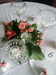 Roses, spray roses,  hypericum,  hosta leaves and succulents.