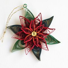 https://flic.kr/p/CrsDdh | Quilled poinsettia with two tone leaves, gold glitter and diamante