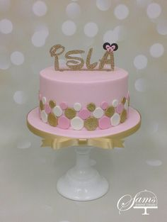 Girls spotting dotty pink, white and gold minnie mouse inspired 1st birthday cake https://www.facebook.com/samssweettreatsuk/
