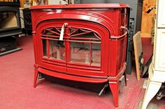 in RED! Nothing better. :) My dad's old Ashley wood burning stove is beautiful. Picture On Wood, Staining Wood, Wood, Living Room Wood Floor, Barn Wood Projects, Painting Wood Paneling, White Wood Floors, Wood Burning Stove, Wood Paneling Makeover
