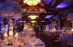 A New York Chic wedding reception in a Gondola with soft blue lighting.