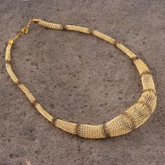 Hey, I found this really awesome Etsy listing at https://www.etsy.com/listing/182958559/gold-bib-necklace-wire-crochet-chunky