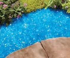 Backyard Landscaping Ideas - Blue Glow Stones: They soak up the sun and at twilight, release it to create a stunning lighting effect along a walk, around a tree, or to highlight other landscape features. Landscaping Around Trees, Landscaping With Rocks, Front Yard Landscaping, Landscaping Ideas, Landscaping Software, Luxury Landscaping, Backyard Patio, Garden Edging, Garden Beds