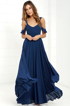 The Romantic Fantasy Navy Blue Maxi Dress will make your wildest wishes come true! Two sets of sheer straps create a cute off-the-shoulder look as they support a darted bodice and cascading maxi skirt, all composed of a lovely woven poly. Hidden back zipper.