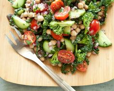 Mediterranean Crunch Salad - chickpeas, cucumber, broccoli, grape tomatoes, kale, red onion, Kalamata olives, red wine vinegar, garlic clove, fresh parsley, fresh thyme