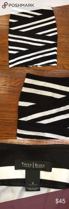 """White House Black Market striped skirt size 0 Lovely White House Black Market striped skirt size 0 with asymmetrical black and white stripes! There's a bit of discoloration on the inside lining, but the outside of the skirt is perfect. It's also missing half of the hook and eye closure.   Approximate flat lay measurements: waist: 13"""", length: 20"""".   Offers welcome. No trades. White House Black Market Skirts"""