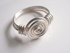 So simple but so cool! Sterling Silver Wire Wrapped Rosebud Swirl by GildedOwlJewelry.