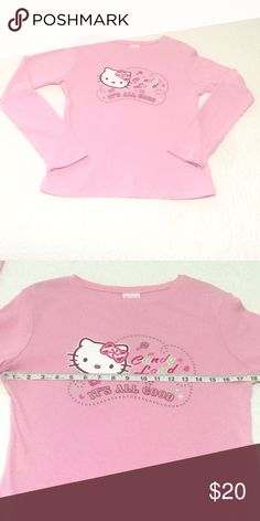 """Kawaii Candy Land Sanrio Hello Kitty Pink Shirt This Kawaii style long sleeve tee-shirt is by Sanrio. This soft 100% cotton top features a pretty cotton candy pink background accented with the words, """"In Candy Land, It's All Good."""" Hello Kitty has a cute candy bow and is surrounded by a sweet pink and green candy ribbon.   Gently used. Smoke-free, dog friendly home. Sanrio Tops Tees - Long Sleeve"""