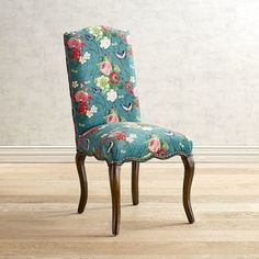 The classic elegance of Louis XV style meets up with relaxed contemporary detailing. A graceful camelback headrest and flirty cabriole legs belie sturdy hardwood construction. Upholstered fabric features a garden of florals and butterflies on a bright teal background and is complemented unexpectedly by a scalloped apron and decorative nailhead trim. Claudine puts the fine in fine dining.