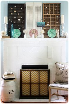 I like the mantle decor but I am loving the fireplace cover; I can even change it with the seasons!!!