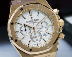 Audemars Piguet 26320OR Royal Oak Chronograph 26320or.oo.d088cr.01, 26320orood088cr01, 18k rose gold case on a brown strap with a rose gold deployment buckle, automatic Audemars Piguet caliber 2385 movement, 40 hour power reserve, chronograph, date at 430, silver waffle dial, applied luminous and rose gold indicators, luminous hands, sapphire crystal, solid case back, size 41mm, thickness 10.8mm, Like New with original box and papers dated 12 /2012.