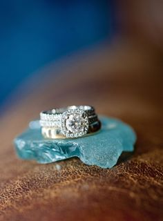 gorgeous wedding ring shot on a piece of turquoise sea glass // image: Jennifer Harvey Photography