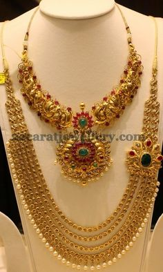 Antique finish gold peacock designer short necklace with simple pota rubies and emeralds all over. Two step designer pendant attached in ...