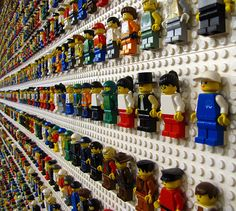 A Wall of Minifigures in a Lego store. You can see how they are stuck to a small flat 2x1 on the back of their legs. Possibly could do this with mine.
