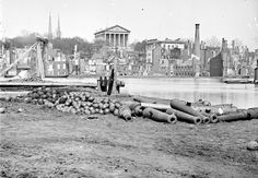 A view of the burned district of Richmond, Virginia, and the Capitol across the Canal Basin, in 1865. The city was assaulted by Union forces for more than nine months during the Siege of Petersburg, after which Confederate Gen. Robert E. Lee's army abandoned the battered city in April, 1865. (LOC) #