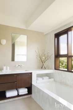 Contemporary White Bathroom with Marble Surround