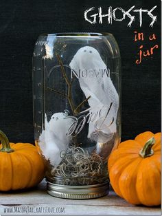 Ghosts in a Jar — the tutorial from Mason Jar Crafts Love shows you how to use styrofoam balls and gauze pads from a First Aid kit for the ghosts. #Halloween #ghosts #diy #tutorials #brightideas