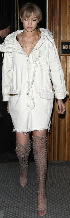 Who made  Gigi Hadids white coat and tan cage thigh high boots?