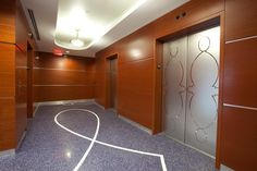 Elevator doors in Stainless Steel with Mirror finish and custom Eco-Etch pattern at 1200 Brikell Bay, Miami, Florida