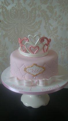 "8"" birthday cake with gumpaste tiara and striped bow."