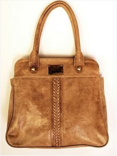 House of Bohemia - The Freedom Leather Handbag (Camel), $180.00 (http://www.houseofbohemia.com/handbags/the-freedom-leather-handbag-camel/)