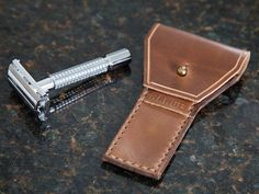 Protect your blade, your hands, and other items in your dopp kit with this handcrafted leather case for safety razors. Leather men's travel accessories are an attractive, useful addition to any guy's packing list and this case is made from full grain leather. It's designed to snugly fit most safety razors.