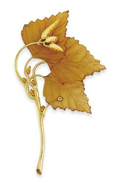 AN EARLY 20TH CENTURY HORN AND ENAMEL BROOCH, BY RENÉ LALIQUE Realistically modelled as a billowing branch with textured bark detail and guilloché enamel bud accents, to the principal carved horn three leaf panel, mounted in gold, circa 1900, 7.9cm long, original maker's case Signed Lalique