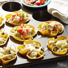 Mexican night has never been easier: Our muffin tin enchilada cups have only five ingredients and take less than an hour to make. Simply fill corn tortillas with chicken, cheese, salsa, and pico de gallo, and dinner is served!