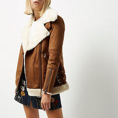 Faux suede with faux fur lining Oversized fit Shearling collar Asymmetric zip front Long sleeves with zip cuffs Zip side pockets and buckled hem