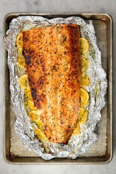 Baked Garlic Butter Salmon Save Print Prep time 10 mins Cook time 15 mins Total time 25 mins This healthy baked salmon is the best way to feed a crowd. There's no skillet cooking at all—everything is oven-baked in fo Salmon Recipes, Fish Recipes, Seafood Recipes, Gourmet Recipes, Cooking Recipes, Healthy Recipes, Drink Recipes, Dinner Recipes, Baked Garlic