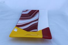 Fused glass rectangular plate/bowl in reds and yellows.