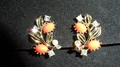 Check out this item in my Etsy shop https://www.etsy.com/listing/107723080/lisner-gold-tone-clip-earrings-coral